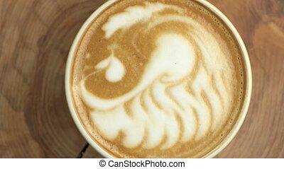 Swan latte art, top view. Texture of coffee foam. Coffee...