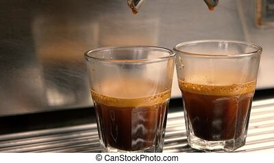 Two glasses with coffee. Coffee drops falling.