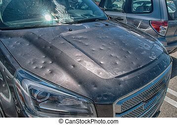 Hail damage to car - Dented car after a big hail storm