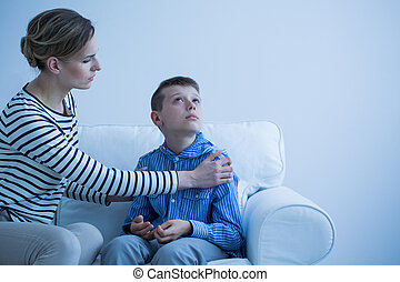 Mother and son on the sofa - Mother and her autistic son...
