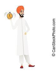 Hindu businessman holding alarm clock.