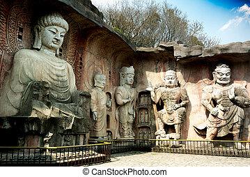 Big stone Buddha on the stone wall at Wuxi Yuantouzhu -...