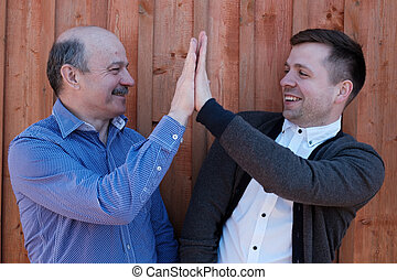 Father and son on wooden background
