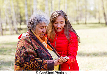 Happy elderly woman with her daughter