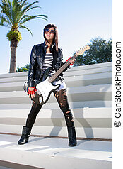 Beautiful Girl with Electric Guitar 1 - A lovely dark-haired...