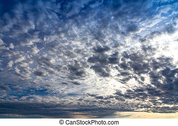 altocumulus cloud at sunset - view of an altocumulus cloud...