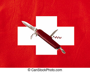 Swiss blade in the middle of a big swiss flag