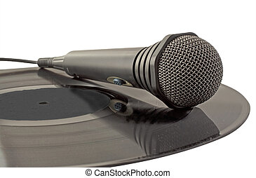 Microphone over vinyl - Black microphone laying over a vinyl...