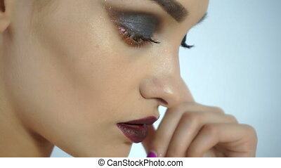 Close up of beautiful young girl with make up and healthy skin