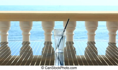 glass of water with ice on the restaurant table overlooking...