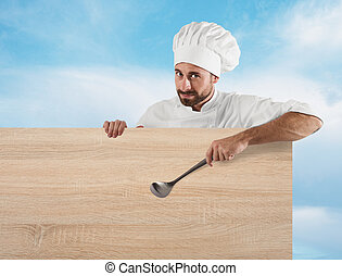 Chef with ladle and board - Smiling chef with ladle...