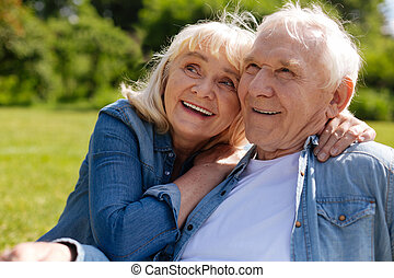 Attractive mature woman embracing her husband