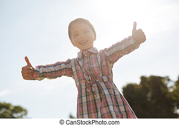 Happy kid actively expressing positivity - I am very glad....