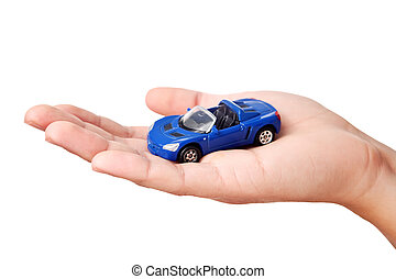 Hand holding small blue car, isolated on white