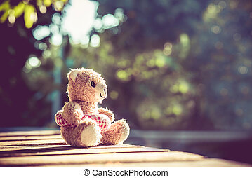 Teddy bear doll, relaxing and lonely, vintage style