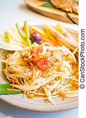 "Spicy papaya salad "" Som tum "" with vegetable - Thai food..."