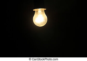 Electric light bulb on a dark background