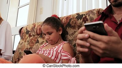 Upset Daughter Explaining The Use Of Smartphone To Mom Dad