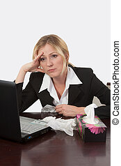 Bored and sick of work - Attractive blond woman sitting at...
