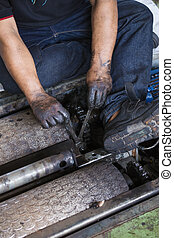 repairman holding a wrench and tighten and during...
