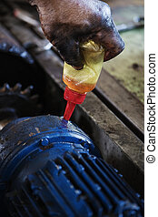 Hand oiling gear and during maintenance work of electric...