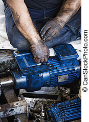 Hand holding hexagonal wrench and during maintenance work of...