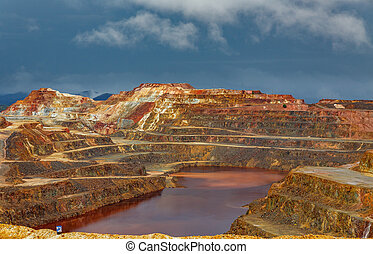 Rio Tinto mine on stormy day - Detailed view of copper mine...