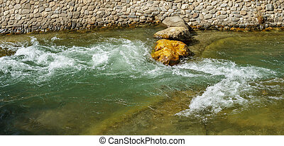 River with prepared rapids - Detailed view of river with...