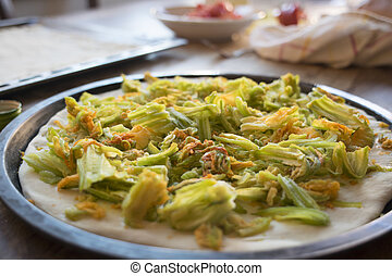 making pizza with zucchini flowers - preparing pizza with...