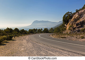 Curvy Olivers road at the curve with misty view of southern...