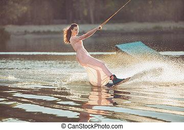 Pretty woman riding a wakeboard. - Pretty woman riding a...