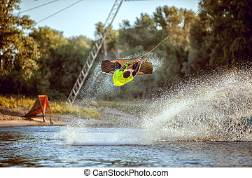 In the jump sportsman wakeboarder. - Above the water...