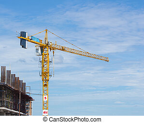 construction crane of building industry with blue sky...