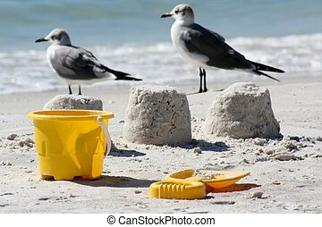 Bucket and Spade - Bucket and spade in foreground with...