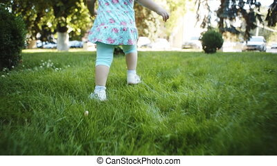Child walking on the grass - Camera moves for walking on the...
