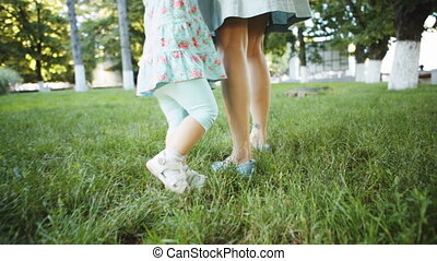Mother and child walking on the grass - Camera moves for...