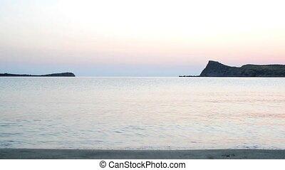 Waiting for sunrise on the beach