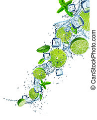 Fresh limes with water splash on white.
