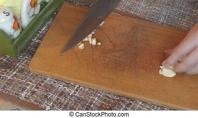 Cutting garlic with a knife