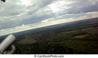 View from window of helicopter - View on forest and field...