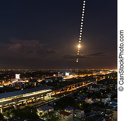 Moon Phases , moon trail over the city pf Bangkok, Thailand-...