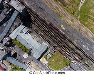 Panorama aerial view shot on railroad tracks with wagons