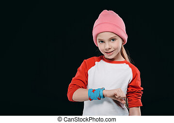 girl in sportswear with sweatband and fitness tracker...