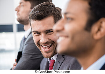 excited business man looking at camera, business concept