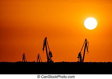 SEVILLE SPAIN - JUNE 25: Landscape of a cranes in a harbor...