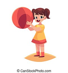 Little girl with inflatable ball standing on beach, summer vacation