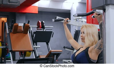 Athletic young woman working out on fitness exercise...