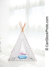 children's tent or wigwam with a dream catcher.