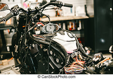 Disassembled sports black motorcycle electronics repair.