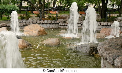 Beautiful fountain in the city park. A traditional place of...
